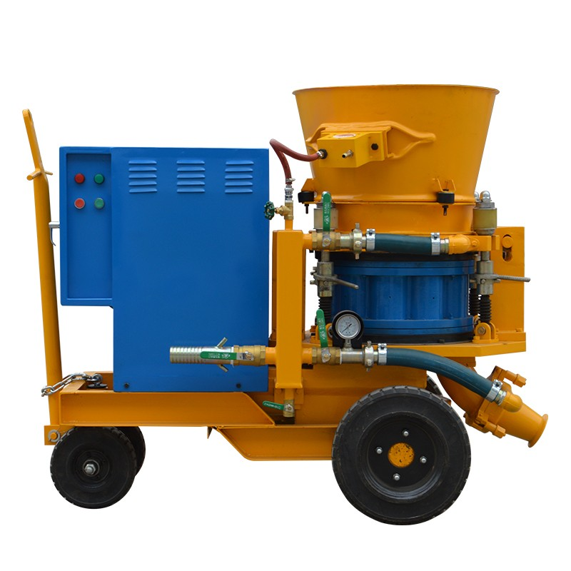 What is the difference between the characteristics of a concrete wet spray machine and a dry spray machine